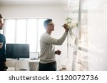 man writing on board in the... | Shutterstock . vector #1120072736