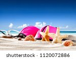 summer photo of shells on sand... | Shutterstock . vector #1120072886