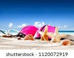 summer photo of shells on sand... | Shutterstock . vector #1120072919