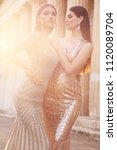 fashion outdoor photo of two... | Shutterstock . vector #1120089704