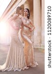 fashion outdoor photo of two... | Shutterstock . vector #1120089710