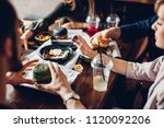 people eating hamburgers and... | Shutterstock . vector #1120092206