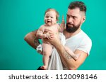 portrait of happy father with... | Shutterstock . vector #1120098146