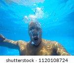 the face of a man under water. | Shutterstock . vector #1120108724