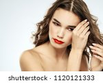 woman straightens hair make up... | Shutterstock . vector #1120121333