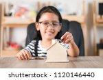 asian little girl in putting...   Shutterstock . vector #1120146440