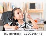 asian little girl doing... | Shutterstock . vector #1120146443