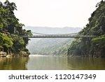 dwaki bridge on umngot river ... | Shutterstock . vector #1120147349