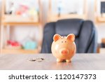 cute piggy bank and coins on... | Shutterstock . vector #1120147373