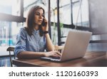 young pretty girl working on... | Shutterstock . vector #1120160393
