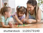 mom and her children playing in ... | Shutterstock . vector #1120173140