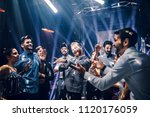 shot of a young man dancing at... | Shutterstock . vector #1120176059