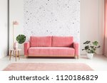 pink couch between plant and... | Shutterstock . vector #1120186829