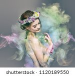 the lady of flowers is half... | Shutterstock . vector #1120189550