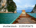 small boat in big lake with... | Shutterstock . vector #1120192673