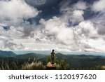 female hiker enjoy view of... | Shutterstock . vector #1120197620