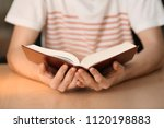 young man reading book at home  ... | Shutterstock . vector #1120198883