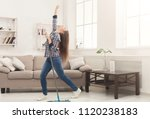 happy woman cleaning home ... | Shutterstock . vector #1120238183