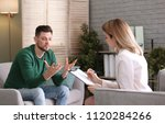 female psychologist with client ... | Shutterstock . vector #1120284266