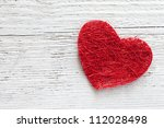 red heart on wooden background with copy space - stock photo