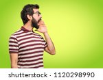 man with glasses shouting on... | Shutterstock . vector #1120298990