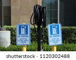 signs at an electric vehicle...   Shutterstock . vector #1120302488