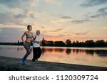 Small photo of Pretty girl's and senior man's evening scamper while sunset. Fitness, crossfit exercises. Fit, strong bodies, healthy lifestyle. Different generations. Outdoors workout on fresh air. Feeling good.