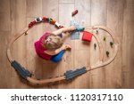 happy child playing with wooden ... | Shutterstock . vector #1120317110