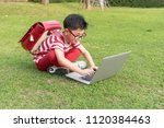 happy asian boy in glasses is... | Shutterstock . vector #1120384463