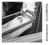 1950s newborn in hospital... | Shutterstock . vector #1120388456