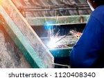 the welder cooks the frame. the ... | Shutterstock . vector #1120408340