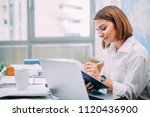 young woman writing in notebook ...   Shutterstock . vector #1120436900