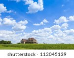 Countryside Home With Cloudy Sky