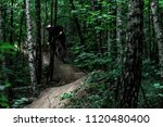 mountain biker jumping in the... | Shutterstock . vector #1120480400