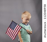 a young boy holds an american... | Shutterstock . vector #112048958