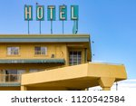 dirty old hotel sign on the top ... | Shutterstock . vector #1120542584