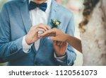 a stylish bridegroom wearing a... | Shutterstock . vector #1120561073