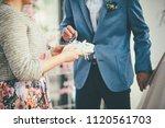bridegroom is taking wedding... | Shutterstock . vector #1120561703