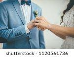 bridegroom put an engagement... | Shutterstock . vector #1120561736