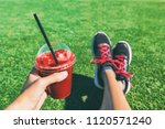 girl drinking red beet or fruit ... | Shutterstock . vector #1120571240