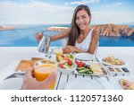 couple eating breakfast at... | Shutterstock . vector #1120571360