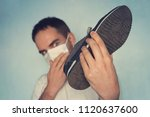 man with mask is holding dirty... | Shutterstock . vector #1120637600
