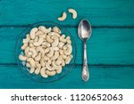 cashew nuts on a vintage or... | Shutterstock . vector #1120652063