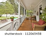 upscale porch with furniture | Shutterstock . vector #112065458