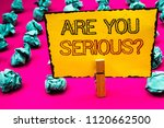 Small photo of Text sign showing Are You Serious Question. Conceptual photo Have to be kidding me Disbelief Is it for real Clothespin hold holding yellow paper black red letters crumpled papers idea.