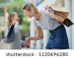 happy woman with shopping bags... | Shutterstock . vector #1120696280