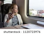 thoughtful businesswoman... | Shutterstock . vector #1120723976
