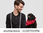 Stock photo people and animals concept friendly looking handsome male looks postively at his favourite dog 1120731596