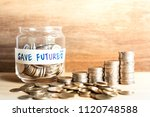 Small photo of A growth of coins for saving money concept,The expend for the future
