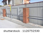 building metal  bricks fence... | Shutterstock . vector #1120752530